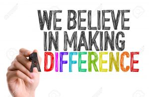 49455458-hand-with-marker-writing-we-believe-in-making-a-difference-stock-photo